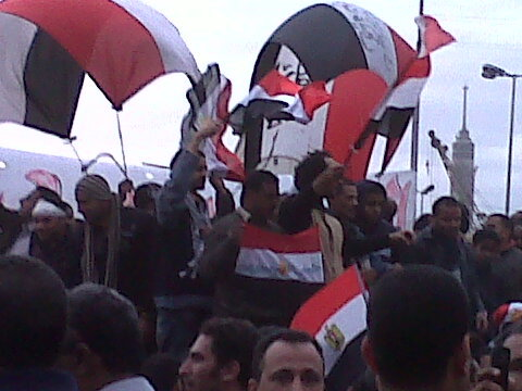 egyptian flags flying high at the tahrir protests today.