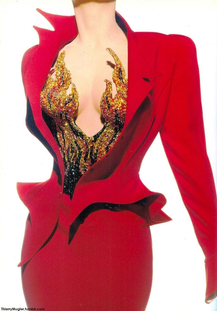 'Dauphine en feu' : Suit in red crepe, jacket with asymmetrical collar and upturned basque, worn over bodice embroidered with precious stones in Graduated flame colors. F/W 88/89