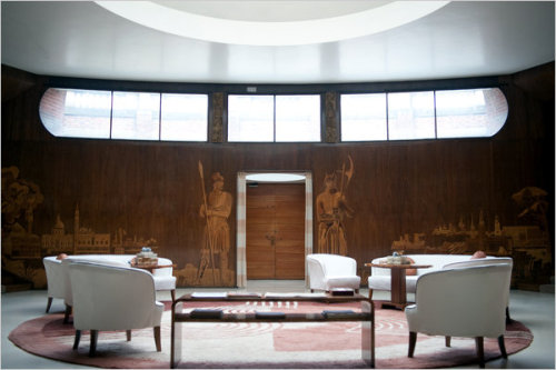 "Eltham Palace, Eltham, EnglandCredit: Andrew Testa for The New York Times I came across this lovely interior — at a home where Henry VIII once lived — via a NY Times feature, ""House Museums in London."" What exactly is this? Here's the NY Times:  Eltham Palace was acquired by Stephen Courtauld, an heir to the British textile fortune, and his wife, Virginia, in 1933. They commissioned the architects Seely and Paget to revamp the estate into a modern home suitable for their considerable entertaining needs.Collaborating with several design firms, the architects delivered an elegant mix of styles that reflected the prevailing tastes of the day. The tone is brilliantly set in the Swedish Art Deco entry hall, designed by Rolf Engströmer and featuring a stunningly original concrete and glass dome. The room's Australian black-bean paneling, with marquetry scenes of Venice and Stockholm, is a showstopper."