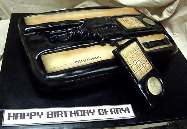 Intellivision Cake.  Not to be racist or anything, but that's sooooo much black icing. That stuff dyes your lips, teeth, and gums and it doesn't wash off for, like, hours. And also, it tastes like black licorice sometimes. Seriously, who likes black licorice? Again, totally not racist.  This was made by Debbie Goard of DebbieDoesCakes. Check out her other awesome video game cakes.  Intellivision Cake Has Way Better Graphics Than Atari Cake - Technabob