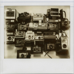 photojojo:  A Polaroid camera stash. Yep, we're jealous. (Photo by rougerouge on Flickr.)  polaroids are just a bit more special. don't you think?
