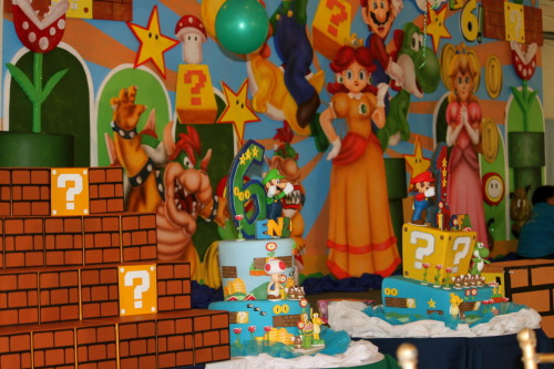Super Mario Bros Party A couple of pictures of the giveaways, the stage backdrop and the fabulous cake!  I wasn't so happy with the likeness of the Mario Bros characters but they were good enough for all the guests so I guess it came out pretty good in the end