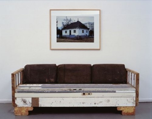 theowlknows:  Loving this couch. :) This picture above it is the demolished house where the materials were collected.