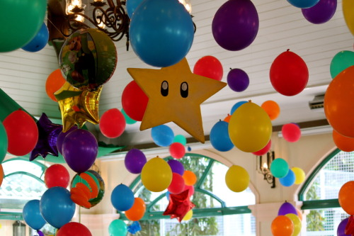 Super Mario Bros themed party A portion of the ceiling decor.  I actually wanted to do Boo balloons but didn't have the time anymore.  The ceiling was cluttered already and an additional element would have probably gone unnoticed as the main action was at the stage