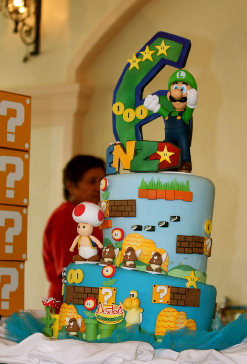 My youngest son who turned 1 was 'Mario' for our party.  My 6-year old son, on the other hand, wanted to be Luigi.  Here's his Luigi fondant birthday cake