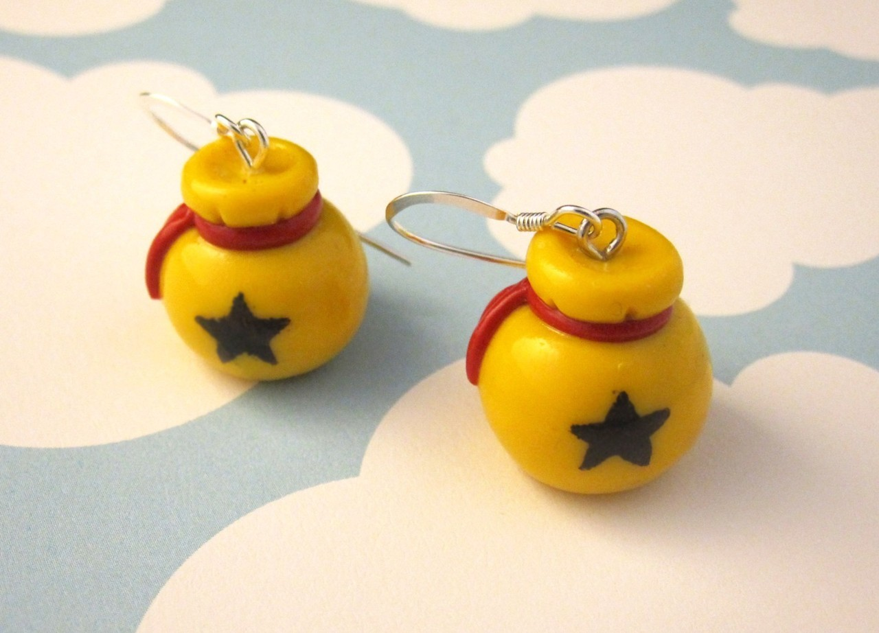 For the ladies: Animal Crossing Bell Bag Earrings by egyptianruin on Etsy. Just don't wear these unless you have your house fully paid off. Don't want any greedy raccoons yanking them right outta' your earlobes.
