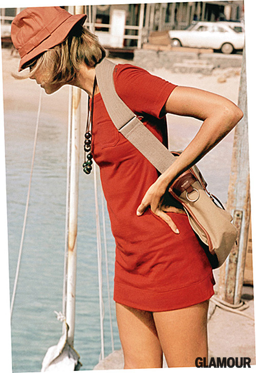 From the May 1970 issue of Glamour To me, this image is all about casual chic. The dress is wearable but glamorous in red, set off by the canvas bag and leather necklace. It's sexy and relaxed—and isn't that how we all want to look? Find four more spring accessories to love, right over here.
