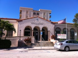 "Lake Worth Public Library (Don't let the sign fool you. There's a book sale every weekend.) Lake Worth, FL ""Good Books Make The Best Companions""  The Lake Worth Public Library was born of the vision of the early pioneer women who settled the place now known as Lake Worth. In 1912 the lots were sold to early settlers. While the men were concentrating on building a city, the women saw the need for a school and a library. In May, 1912, The Lucerne Herald (as the local newspaper was called then), carried an appeal for all to send books to set up a library. Mr. and Mrs. John L. McKissock pedaled their bicycles the seven miles to West Palm Beach to pick up the donations as they arrived. Soon the town furnished a room for the rapidly growing library. The local people read the books by candlelight, oil and gasoline lamps until May 1914 when electric lights were turned on in the city. The Library is proud to point out that there was a library in Lake Worth five months before the first school and nearly two years ahead of the lights.The Lake Worth Public Library is housed in a Mediterranean type building in the historic downtown section of the City. Although air conditioning was not installed in the original building, air ducts were constructed in the walls; this foresightedness was appreciated when it was added.Through prudent investment and a fund raising campaign, a new library building was erected in 1941 and a dedicatory service was held August 12, 1941. The Lake Worth Public Library was officially open in its first true home.  submitted by yopinksushi"
