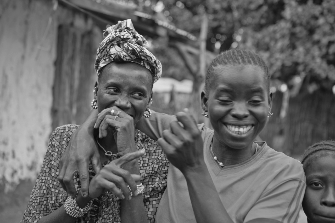 'Images from the road' - Gambian village chief's daughter shares a joke with her friend, Chamen Sosseh, The Gambia, West Africa 2009 More images from the 930km expedition can be seen on: http://www.flickr.com/photos/expeditionafrica/page1/ Image by Jason Florio