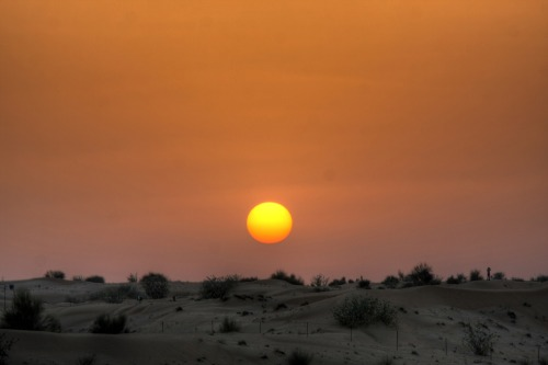 Dubai 2011 - The Sunset in the Desert A wonderful sunset in the desert. The sun was a total yolk round which wasn't even blocked by anything, no structures and whatever. It was a kind of reminder that every single day will come to an end and so will our problems. It's like a departure or the vanishing of a problem that we hand into God's arms when the day ends just as Matthew 6:26 :)