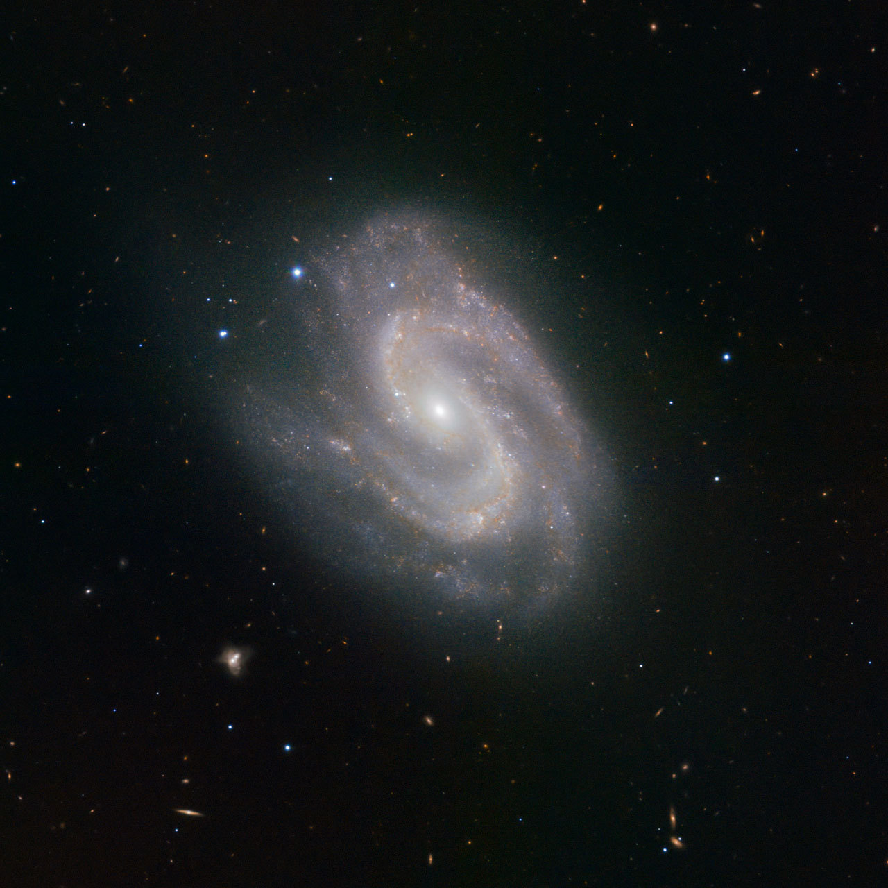 "ESO's HAWK-I Instrument Spies a Super Galaxy The HAWK-I instrument on ESO's Very Large Telescope (VLT) at the Paranal Observatory in Chile has been used to great effect in producing this distinctive image of the distant galaxy NGC 157. Boasting a central sweep of stars resembling a giant ""S"". HAWK-I detects infrared light, allowing us to peer through the gas and dust that normally obscures our view. This reveals an otherwise hidden view of the Universe, and gives astronomers the opportunity to study dense areas of star formation. Learning more about star formation is an important step towards expanding our understanding of our own origins. The same processes that are coalescing material in NGC 157 and creating stars there took place around 4.5 billion years ago in the Milky Way to form our own star, the Sun. NGC 157 is faint at about magnitude 11, but can be tracked down by dedicated amateur astronomers. It is located within the constellation of Cetus."