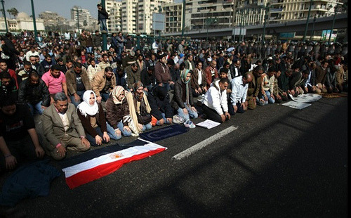 "beingblog:  What Does This Photo of Men and Women Praying Together in Tahrir Square Signify? by Nancy Rosenbaum, producer On February 1st, this photograph was posted on Twitter with the caption:  ""In Tahrir Square in Cairo, men and women pray together just like at the Haram in Makkah, gender boundaries have been transcended and the only thing that matters is that they are Egyptians who want freedom!""  To see Muslim women and men praying next to each other in an Egyptian public square is worthy of noting. We wonder what it suggests about bigger changes afoot in Egypt? We reached out to commentators Melody Moezzi and Mona Eltahawy via Twitter for some context and perspective. Moezzi replied: ""In the time of the Prophet, men and women prayed side by side. Today in Mecca, men and women pray side by side. This should be good enough for the rest of the world then — to end segregation in mosques and in prayer. That's what the comment is getting at."" Eltahaway reached out to her broad sphere of followers on Twitter. One of Eltahaway's Twitter followers added (with a smiley emoticon appended to the end: ""The segregation angle comes into play only when you are inside a mosque. Believe it or not, Islam is a flexible religion."" What do you see in the photograph that might add to our understanding? Do you have other insights that might train our eyes to see differently? Are there details to which we should pay greater attention, which, in turn, would add to its meaning and significance? (photo: S. Habib/Twitpic)"
