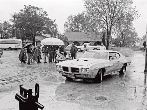 "Pontiac GTO — During the filming of Two Lane Blacktop (1971). ""Not even the rain halted shooting of Two-Lane Blacktop. In fact, Monte Hellman credits the rain for adding excitement to an otherwise slow-paced scene when the characters arrive in Boswell, Oklahoma, early in the morning to find the town asleep.  Things were so organic on the set that there was no makeup artist.  The actors were simply instructed to ""get a tan"" before shooting began."" Check it out."