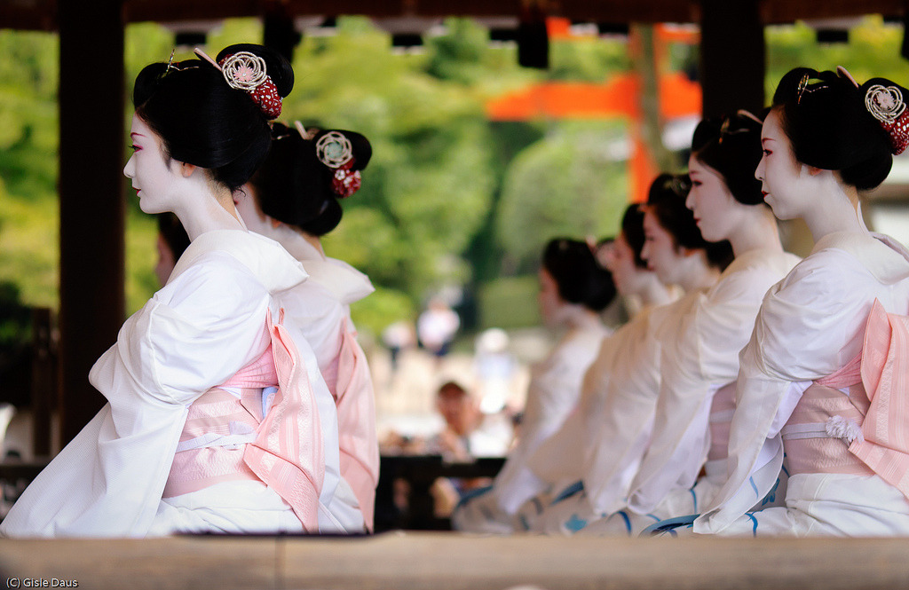"nakamagome2:  Maiko's Performance, Gion Festival, Kyoto  Maiko are young women, usually late teens, who are apprentice geiko/geisha so to speak.  They are not at ""professional"" level in their arts.  Observe the precision of these young women.  They're lined up like Radio City Rockettes, parallel limbs, chins and necks poised at the same degrees.   It's appalling how geisha have been fetishized as high class prostitutes and courtesans in western culture.  There were women who became prostitutes in order to survive in post war (WW II) Japan.  They were nicknamed ""geisha girls"", and the misnomer and stereotype took."