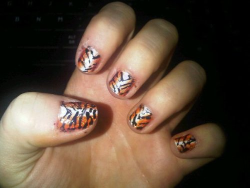 my tiger print nailsss they look great from afar but were so hard to do and went sloppy so i'm just going to avoid anyone looking at them up close haha