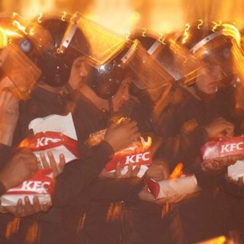 npr:  Photo of Egyptian security services eating KFC near Tahrir Square, Cairo. The Tahrir Square KFC has served as a supplier of free food to protesters. Photo taken by an anonymous protester; date unknown. #Egypt #jan25 (Taken with instagram)  KFC: They do protests right.  Not that this is the vector that this should be considered, but we're not sure how successful of a branding strategy this is. Good on them for feeding everyone for free.