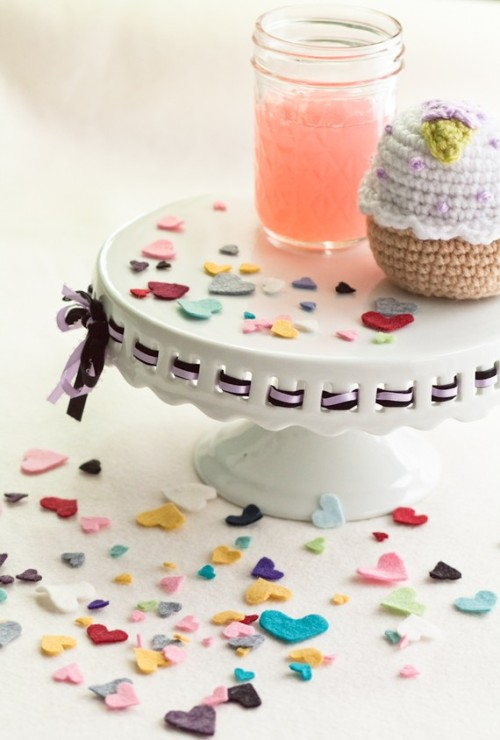 sprinkling confetti (be it heart-shaped or not) all over breakfast/lunch/dinner table is also an adorable idea. Felt Heart Confetti by LilacSaloon on Etsy