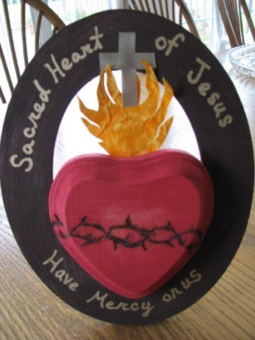 Sacred Heart Craft My husband and I teach a Sunday Religious Education class.  Our sixth graders have been doing a lot of bookwork/worksheets recently so I've been wanting to do a craft with them to spice things up.  Since Monday is Valentine's Day, I decided that we would do a Sacred Heart craft.  I'm not very good at coming up with my own crafts, but I can follow directions, so I searched the internet hoping to find something, and this is what I found!  Isn't it great?  David and I will go buy the supplies and try it out this Saturday, and as long as it goes well, our students will be making these on Sunday (as well as getting a lesson on the Sacred Heart).  For the full post and directions how to make this (and an amazing blog altogether), go visit Kimberlee at Pondered in my Heart.