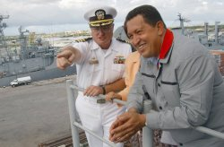 "Hugo Chavez would not normally make it on my ""best dressed list"" - His propensity for collared shirts with a clashing tee underneath just makes him look more like a wrestling coach than he usually does — but then I saw this! Congratulations Hugo! By accessorizing your signature outfit with a charcoal Members Only jacket - you have a look that is both populist and popular!"