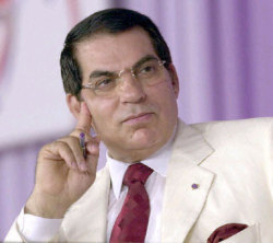 Zine Al Abidine Ben Ali's summer chic would fit in in his new home of Saudi Arabia or in the tango dance halls of Buenos Aires (see the upcoming post on vintage Dapper Dictators). Ben Ali is pure dapper: White linen dinner jacket, crisp shirt, crimson silk tie and matching kerchief square. His wife,  Leila Trabelsi - a fashion plate in her own right - reportedly stole 1.5 tons of gold on her way out of Tunisia - I can't wait to see her new jewelry line.
