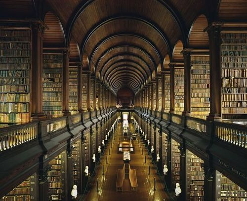 booklust:  Trinity College Library, Dublin  I'm in Ireland right now — more on that later — and, well, have you ever seen a place so perfect that time and reality seem to go a bit fuzzy?  Yep.