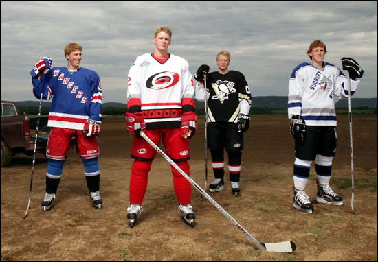 Marc Staal: I'm in a full laugh in the picture. The other three guys are holding it in and squinting and stuff. My mom's like trying to tell the photographers what to do. Mom, they're professional photographers - what are you doing? And I couldn't stop laughing.