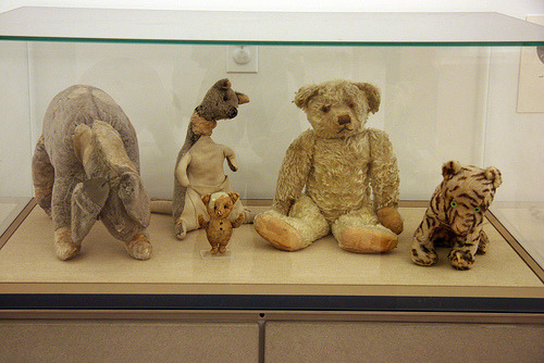"""Pooh and his friends were given as gifts by author A. A. Milne to his son Christopher Robin Milne between 1920 and 1922. Pooh was purchased in London at Harrods for Christopher's first birthday. Christopher later gave them to publisher E. P. Dutton, who in turn donated them to the New York Public Library."""