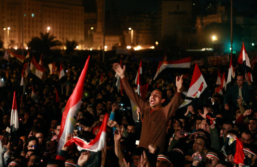 PHOTO OF THE DAY: A crowd of Egyptians in Cairo react to the news that President Hosni Mubarak had stepped down on Friday. (AP Photo/Ben Curtis)