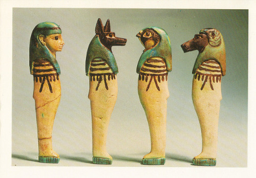 "Here's a postcard of Ancient Egyptian Art from the British Museum. Enjoy! I apologize again for not posting much on this blog. I promise things will be back to normal soon and I'll be writing more about some of my favorite museums. ""These flat-backed glazed composition amuletic figures of the Four Sons  of Horus would have been set within the wrappings of the mummy to  protect the internal organs. The human-headed deity is Imsety; the  jackal-headed, Duametef; the falcon-headed, Qebhsenuef; and the  baboon-headed, Hapy. Since the stoppers of the canopic jars containing,  respectively, the liver, stomach, intestines and lungs were carved in  their heads, these gods are often known as the canopic deities. Late New  Kingdom (ca. 1000 BC)"" (Image Source)"