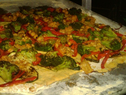 Grilled Veggie Pizza with a Chickpea Crust  for crust: 2 cups warm water and add 2 oz yeast, 1 tbs sugar and let sit for 15min. Add in 4 cups chickpea flour slowly with some olive oil, fresh rosemary, salt, pepper. Mix until almost stiff then knead. Move to a lightly oiled bowl and cover with a clean towel let sit for 30 minutes then roll out on a floured surface. Bake for 10min ad 300F then take out of the oven until ready to top with veggies. grill broccoli florets, red bell peppers, onions and zucchini mash up 3 cups chick peas with minced garlic and olive oil, mash coarsely and spread over crust, then add veggies.  In a small bowl mix cumin, paprika, salt, pepper and oregano. sprinkle mix over pizza.  Bake at 350F for 15minutes.  Drizzle with balsamic reduction and serve :)  Not gluten free, but protein pact and delicious! -cristi