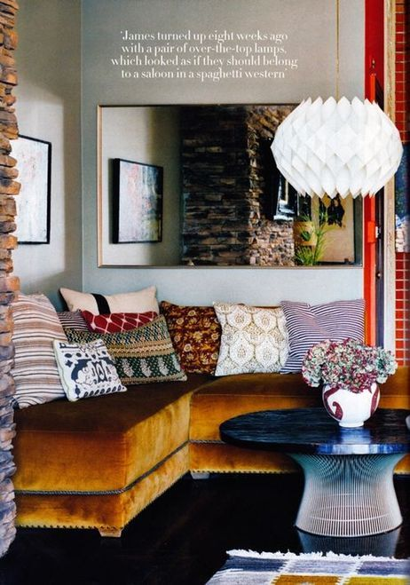 Gorgeous sectional with perfectly layered pillows.  Boho glam at its best!