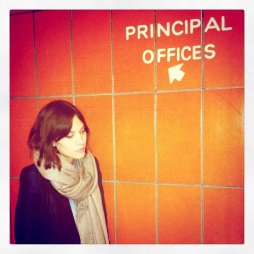 Alexa Chung on her way to the principles office. Photographed by Andrew Bevan at a NYC highschool where the Rachel Antonoff presentation was held.
