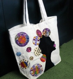I love these natural hair inspired tote bags by Quelly Rue Designs! Check her out here - http://www.etsy.com/shop/QuellyRueDesigns?section_id=7472792