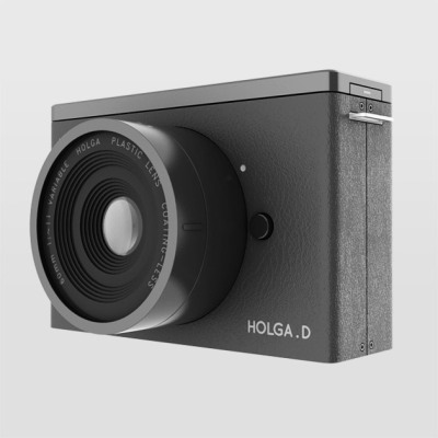 "A digital camera that offers ""delayed gratification""  Holga. D bills itself as the perfect camera for people who are nostalgic for the blurry, leaky, yellowy photos of yore, but still attached to some of the conveniences of digital technology, which is pretty much everyone over the age of 20, right? Designed by Finland-based Saikat Biswas, Holga. D mimics the original Holga — that crappy, bare-bones, made-in-China toy camera that can't take a decent picture to save a life — in nearly every way, except that it's rigged to download images. But, like an old Holga, it doesn't have a display window so you can't actually see the images until you throw 'em on your computer. And like an old Holga, the biggest feature is, in Biswas's telling, ""lack of features!"" No fancy sensors, no micro-lenses, no nuthin'. The point: to bring ""back the joy and delayed gratification associated with good old analog photography."""