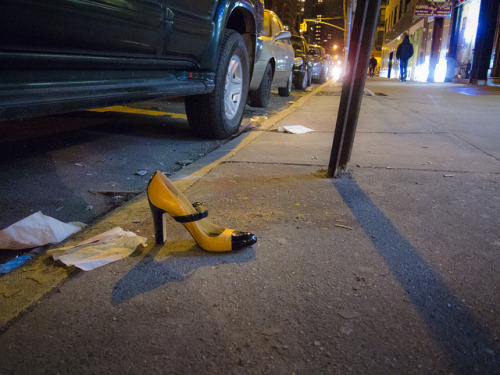 Cinderella in Taxi Heels (by Dave H.) Abandoned shoe on 1st Ave in Manhattan, Saturday night.