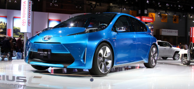 Toyota Prius C Concept at the 2011 Chicago Auto Show via itcars Learning car photography has influenced how I try to approach fashion photography. This weekend, it was apparent how fashion photography has influenced how I approach shooting cars.  Many of the photographers works I enjoy generally slightly overexpose the models. At the show, I ran with a slow shutter speed with a low f-stop (for cars) to help try and bathe the subject in light for dramatic effect.
