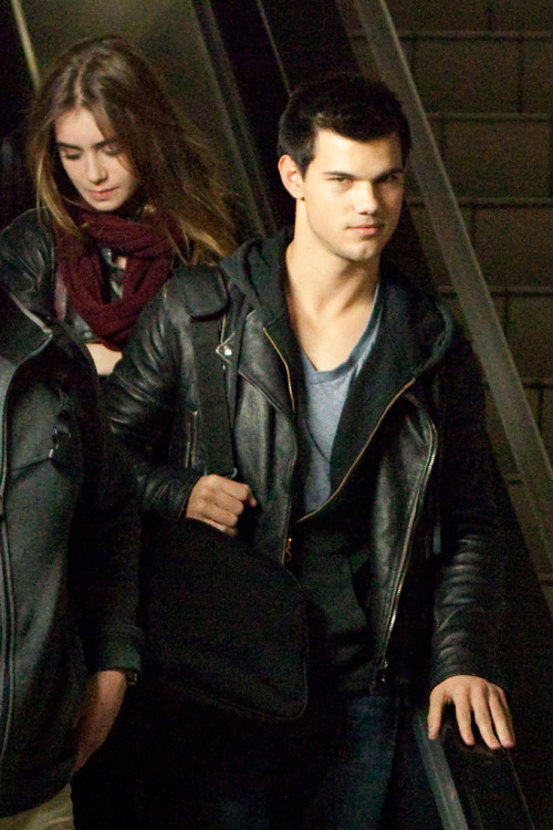 Taylor Lautner and his Abduction co-star Lily Collins arriving at LAX off a late night flight.