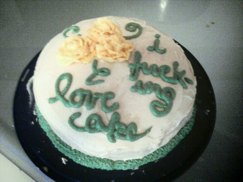 "[white cake with green icing and yellow roses that says, ""I fuck-ing love cakes"" in cursive] transartorialism:  it's truei made this, frosting roses included. it's all vegan, vanilla cake, vanilla frosting, raspberry jam in the middle  I think that it's the hyphen in ""fucking"" that is making me giggle so much about this cake, but omg. Want want want."