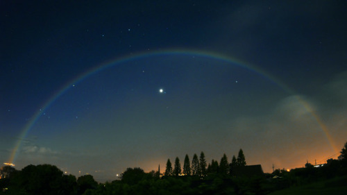 whiterainbows:  A white rainbow (also known as a lunar rainbow, lunar bow or moonbow) is a rainbow produced by light reflected off the surface of the moon rather than from direct sunlight. Moonbows are relatively faint, due to the smaller amount of light reflected from the surface of the moon.
