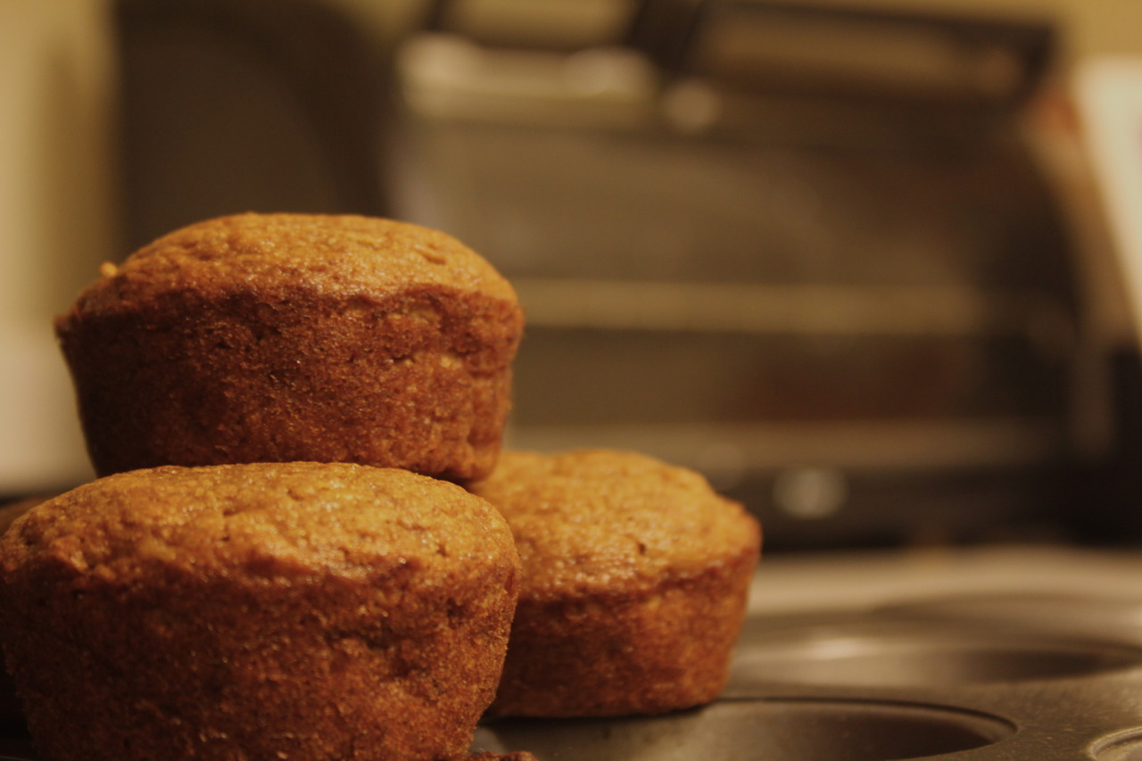 Banana-Applesauce Spice Muffins I really, really love these. And they're healthy! I didn't take any picture of the process, but it was a pretty boring looking process, so you're not missing anything. So here's the recipe! 1 egg  3 mashed ripe bananas 3/4 cup brown sugar  1/3 cup applesauce (the regular, unsweetened kind) 1 teaspoon vanilla extract 1/2 cup all-purpose flour  1/2 cup whole wheat flour 1/2 tsp baking soda  2 tsp baking powder  1 teaspoon cinnamon A couple dashes of ground cloves and ginger (optional) 1/3 of an apple, finely chopped  Preheat the oven to 350 degrees. Grease/flour or line 12 baking cups. In a large bowl, stir together egg, bananas, brown sugar, applesauce and  vanilla. In a separate bowl, mix both flous, baking soda,  baking powder, cinnamon, ginger, and cloves. Stir in the chopped apple into liquid ingredients. Gradually stir dry ingredients into the liquid mixture.  Pour batter into the muffin cups. Bake for 20 minutes. Not only do these taste delicious, they're also really healthy, and they make the whole house smell so good. I can't emphasis enough how wonderful my apartment smelled all day.