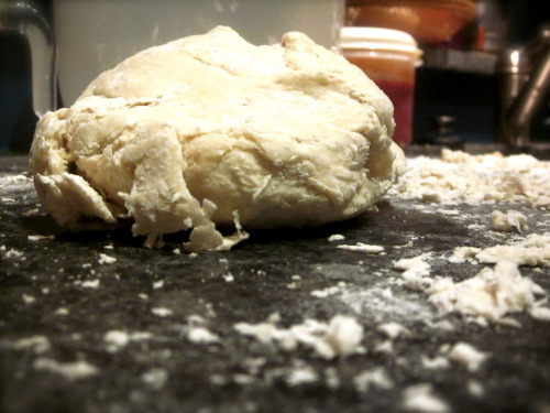 I decided to try a new dough recipe today. This is a big deal - since I'm a huge fan of my usual dough recipe, but the time was right and I was feeling adventurous (not that adventurous, there are only minor ingredient differences).  Pizza Dough Recipe out of Jamie At Home: (I froze 1/3 of the dough & used the other 2/3 to make 4 LARGE calzones) 7 cups strong white bread flour 1 tablespoon fine sea salt 2 - 1/4 oz packets of active dry yeast 1 tablespoon raw sugar 4 tablespoons olive oil 2 1/2 cups of luke warm water Like normal, let the water and yeast sit. Then mix in everything else. Flour your hands - work it well. Cover and let sit for 45 minutes - 1 hour. Knead out the air bubbles. Split into as many pieces as you want. Freeze, or roll and use. The dough turned out great for the calzones!