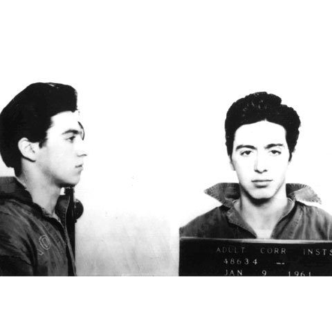 January 7th, 1961: Al Pacino was arrested on this date in Woonsocket, Rhode Island, for carrying a concealed weapon. At the time, he was 21 years old, and was living in New York City. He stayed in jail for three days, along with two of his friends. All three were wearing black masks and gloves while driving around prior to their arrest. The initial arrest report states that a .38 caliber pistol was found in the trunk of the vehicle. According to Pacino and the other two men, they told the police that they were actors who were traveling to an acting gig in New York City, and were using the gun for their roles. While Pacino was cooperative and friendly with the police, he could not pay the $2,000 bail at the time, and spent three days in jail instead. He was released on January 9th (the date the above mugshot was taken). Charges were later dropped.
