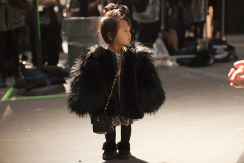 Alexander Wang's niece.  Rocking a Chanel purse!
