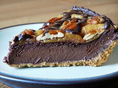 """Chocolate Smlove Pie"" Chocolate amaretto pie with peanut butter caramel and maple candied pecans drizzled with chocolate ganache"