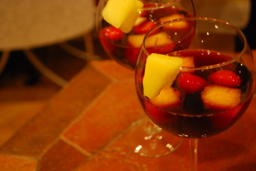 Ed Hardy Sangria with some frozen strawberries, blueberries, and pineapple. Yuuuuuummy.