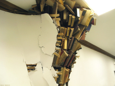 "charmingtreasures:  Wary Meyers books installation ""The Basement Stacks"" for the  basment of the old Baxter Library Building in Portland Maine, newly  occupied by the Via Advertising Agency. This one's in the basement,  referencing the old library, history, roots, poltergeists…"