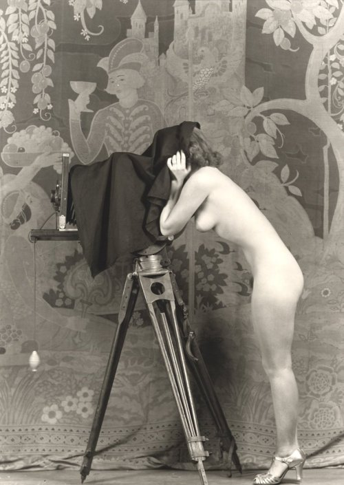 Woman with camera. Photo by Alfred Cheney Johnston, 1920