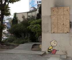 thedailywhat:  Additional Street Art of the Day: A second Banksy piece has already been spotted in LA, this one featuring a mischievous Charlie Brown. Is the next one being stenciled outside your door right now? (Go check!) [wooster.] Earlier: The Crayola Shooter.