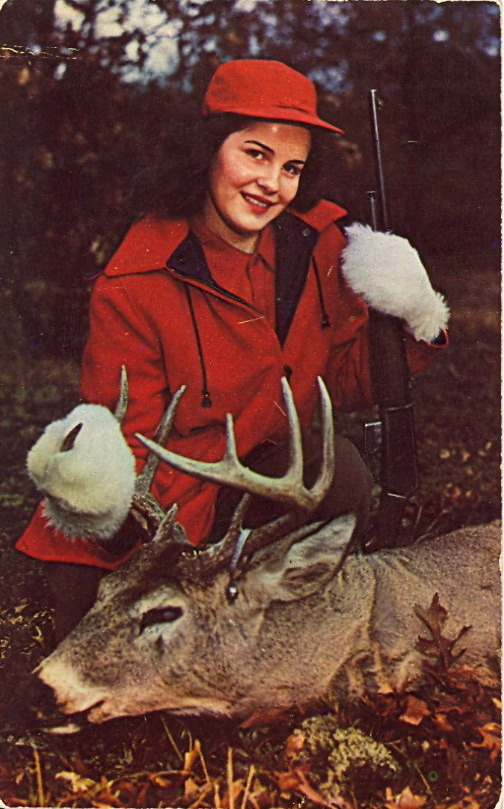 A MODERN DIANA PROUDLY EXHIBITS HER KILL IN MAINE That's what's printed on the card.