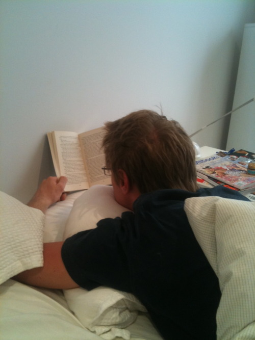 hotguysreadingbooks:  As celebration to the fact that I've finally moved back home, here's a hot guy reading in bed! Because nothing is better than climbing in your bed with a book after not having it for a week. And to the lovely submitter who asked how does one sleep in the same bed if he's reading: I've always figured you were supposed to just read your own book until you both passed out! Though I'm not exactly the best one to ask; I tend to be the guy reading like that in the first place while people wait up for me. thanks, Margot! —Posted by Brandon
